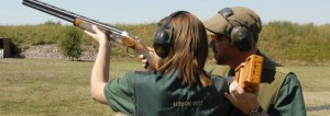 being taught to shoot at a clay shooting club
